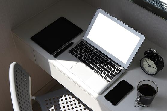 blank screen laptop computer and smart phone and digital tablet and stylus pen is on wooden desk as workplace concept.jpeg